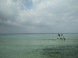 Log swing in the sea, Coconut Beach, Koh Rong Island, Cambodia