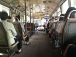Hardwood floors on a city bus. Bangkok, Thailand